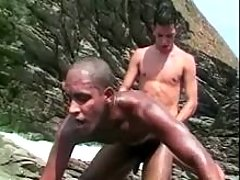 White man-lover pounds black by the sea