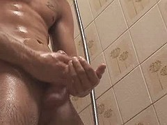 Nice-looking fellow jerks off his stiff pecker in the bathroom