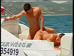 2 guys smokin' and blowing on a boat in 3 episode