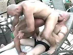 3 mature homosexuals have fun by pool