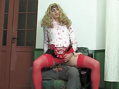 Golden-haired submissive chap in female clothes getting arse penetrated in per which standing