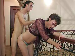 Lascivious submissive in a see-through blouse swallowing a hard schlong and anus riding
