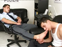 Beautiful twink licks legs of policeman