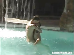 Pretty faggot pals kiss in pool