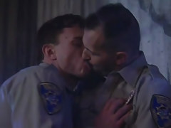 Passionate policemen kiss per other