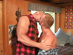 Horny man-lovers kissing in sofa