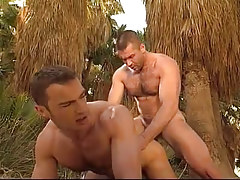 Hirsute gay man fucks male in doggy style in jungle