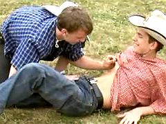 Adorable lil cowboys enjoy blowjob strokes on grass