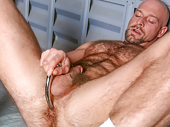 Dirk works over his hirsute muscular body & probes his arse