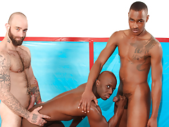 Athletes Sam & Tyson take teach Jay on the wrestling mat